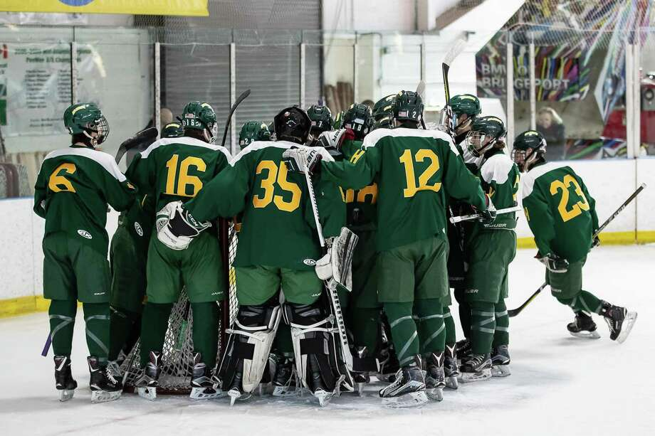 Hamden gathers around their net for pre game pep talk just before the opening puck drop of a game between Hamden Varsity Boys Ice Hockey and Fairfield Prep Varsity Boys Ice Hockey on January 26, 2018 at the Wonderland of Ice in Bridgeport, CT. Photo: John McCreary / For Hearst Connecticut Media / Connecticut Post Freelance