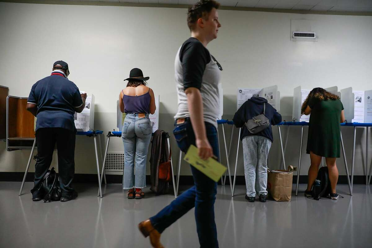 People vote Registrar of Voters office in Oakland, California, on Monday, Nov. 5, 2018.