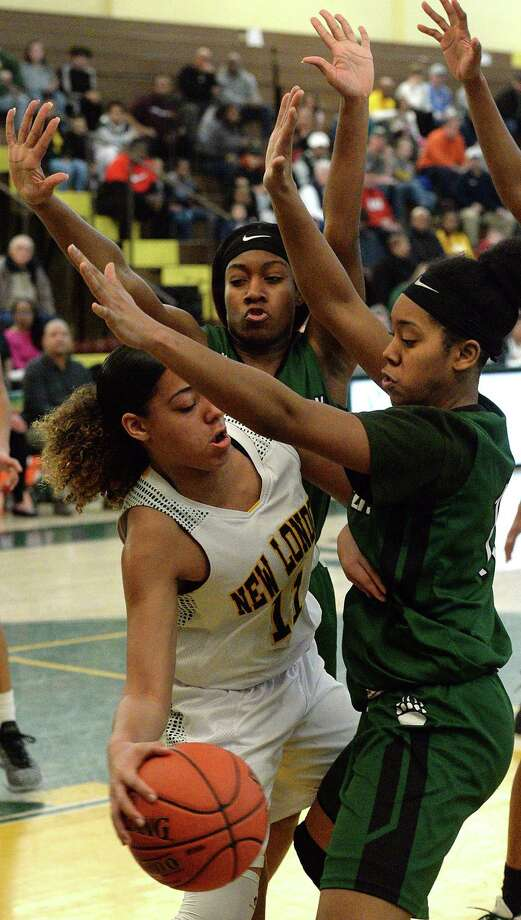 New London's Spencer Roman (11) tries to pass the ball around Norwalk's Sanaa Boyd (12) and Anaijah Morgan (11) during Saturday's game at New London High School. Photo: Dana Jensen / The Day / Day Publishing Company 2019