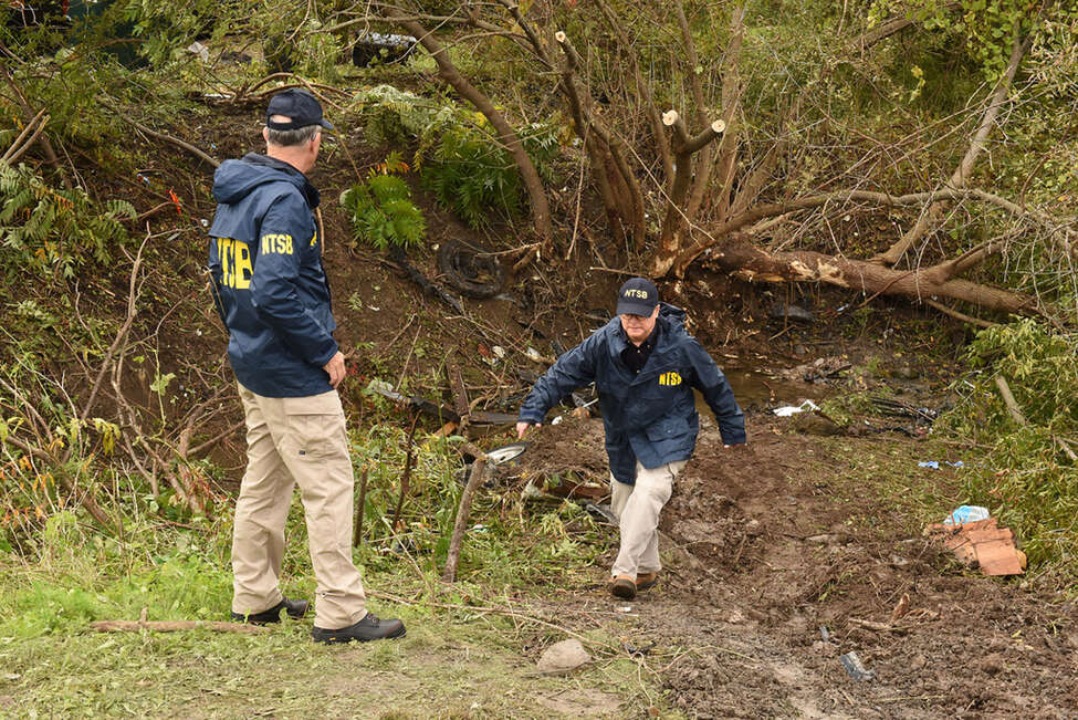 Members of the NTSB survey the scene of an accident that happened next to the Apple Barrel Cafe at Rt. 30 at Rt. 30A Saturday afternoon involving a limousine on Sunday, Oct. 7, 2018 in Schoharie, N.Y. (Lori Van Buren Times Union)