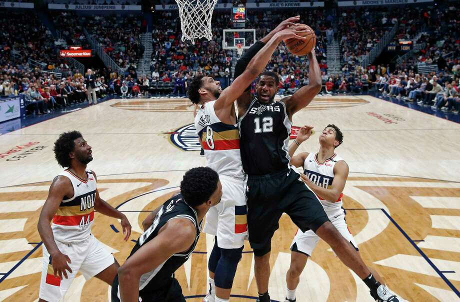 San Antonio Spurs center LaMarcus Aldridge (12) battles under the basket against New Orleans Pelicans center Jahlil Okafor (8) in the first half of an NBA basketball game in New Orleans, Saturday, Jan. 26, 2019. (AP Photo/Gerald Herbert) Photo: Gerald Herbert, Associated Press / Copyright 2019 The Associated Press. All rights reserved.
