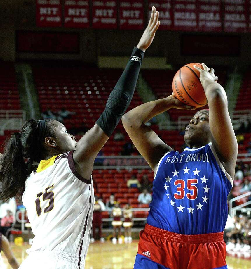 West Brook's Nyrah Hutchings shoots during last season's double-header girls and boys games at the Montagne Center. Photo taken Saturday, January 26, 2019 Photo by Kim Brent/The Enterprise Photo: Kim Brent, The Enterprise / BEN