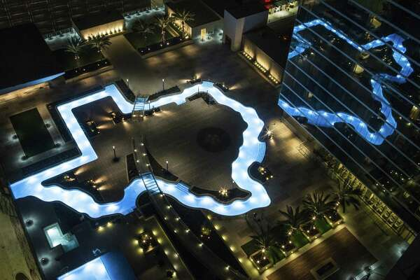 The Texas-shaped lazy river pool is lit up during the grand lighting ceremony at the Marriott Marquis hotel on Monday, Dec. 26, 2016, in Houston. ( Brett Coomer / Houston Chronicle )