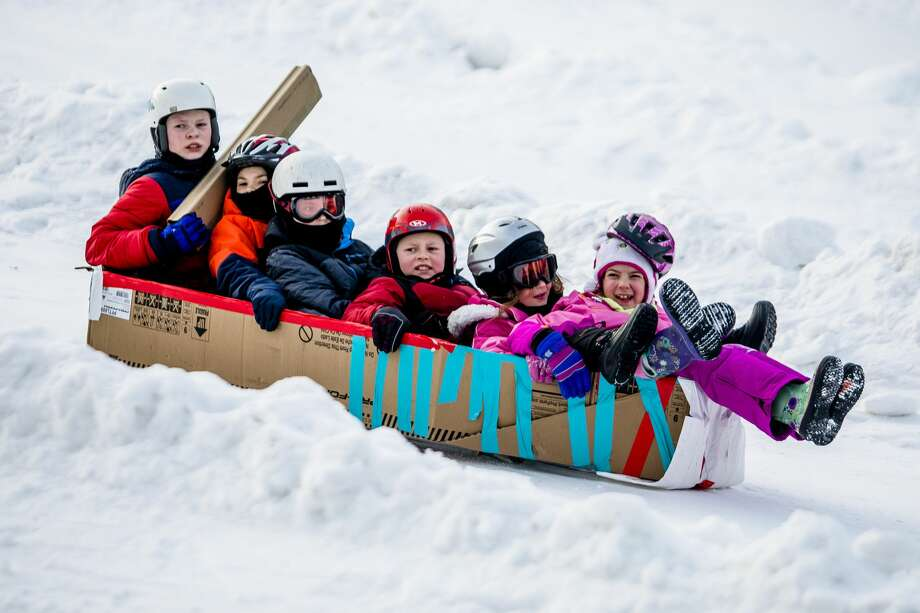 Kids race down the sledding hill in homemade cardboard sleds on Saturday, Jan. 26, 2019 at City Forest. (Katy Kildee/kkildee@mdn.net) Photo: (Katy Kildee/kkildee@mdn.net)