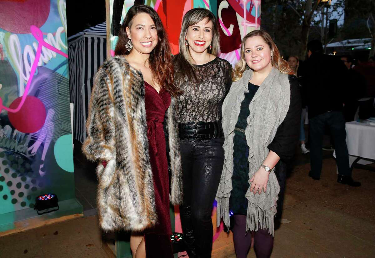 Runway Spring Fashion Show attendees pose for a photograph at Discovery Green on Saturday, Jan. 26, 2019, in Houston.