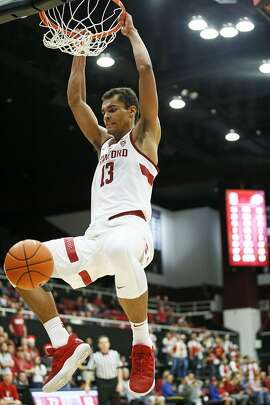 Stanford Cardinal forward Oscar da Silva (13) dunks against the Colorado Buffaloes in the second half of an NCAA basketball game at Maples Pavilion on Saturday, Jan. 26, 2019, in Stanford, Calif. The Cardinal won 75-62.