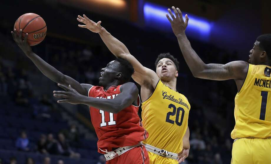 Utah's Both Gach lays up a shot past Cal's Matt Bradley (20) and Darius McNeill in the second half at Haas Pavilion. Gach scored 18 off the bench. Photo: Ben Margot / Associated Press