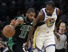 Boston Celtics guard Kyrie Irving (11) dribbles against Golden State Warriors forward Kevin Durant (35) in the first quarter of an NBA basketball game, Saturday, Jan. 26, 2019, in Boston. (AP Photo/Elise Amendola)