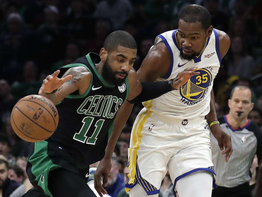 60d9e6ae8f2 Boston Celtics guard Kyrie Irving (11) dribbles against Golden State  Warriors forward Kevin Durant