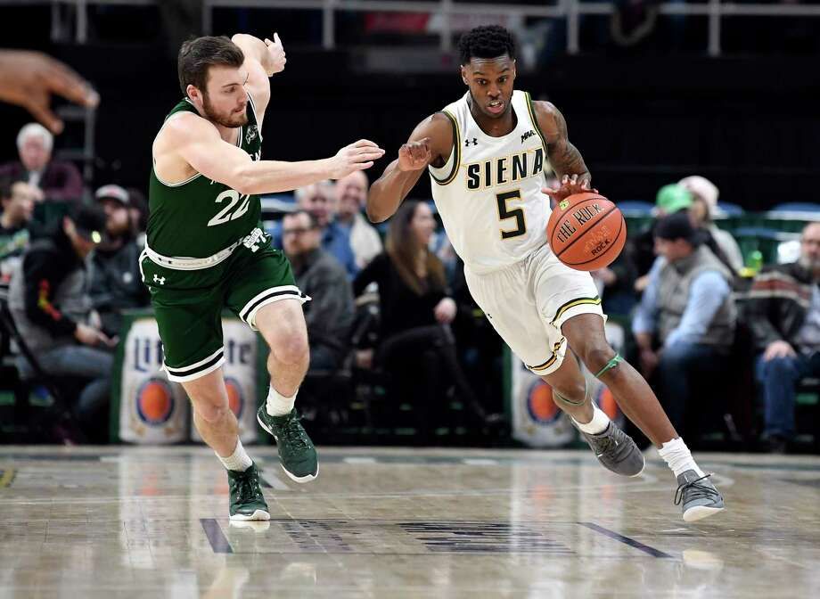 Manhattan guard Thomas Capuano (22) defends against Siena guard Kadeem Smithen (5) in the first half of a Metro Atlantic Athletic Conference NCAA college basketball game, Saturday, Jan. 26, 2019, in Albany, N.Y. Photo: Hans Pennink, Times Union / Hans Pennink