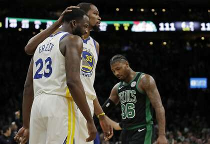 0e25d2f6c8cc Golden State Warriors forward Kevin Durant (35) embraces teammate Draymond  Green (23) as Boston Celtics guard Marcus Smart (36) walks by late in the  fourth ...
