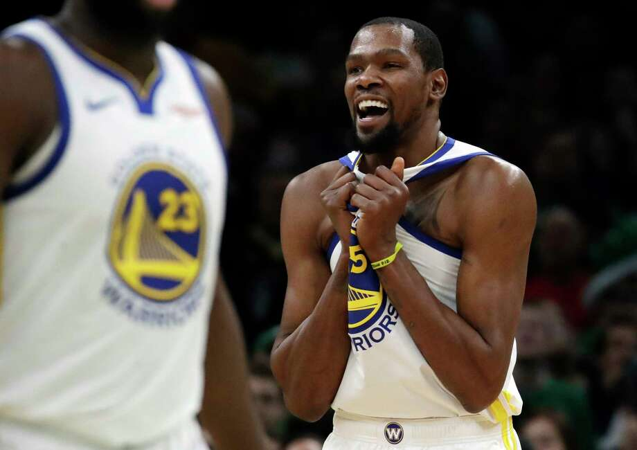 3b4a4c4b6e7 Golden State Warriors forward Kevin Durant (35) celebrates in the final  seconds of an