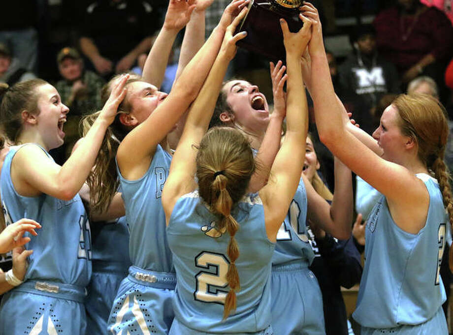 Jersey seniors Hannah Hudson (right) and Brooke Tuttle (2) bring the championship trophy back to happy teammates includine (from left) Boston Talley, Clare Breden and Abby Manns after the Panthers' overtime victory over top-seeded Jacksonville Routt on Saturday night in the 45th annual Carrollton Tournament. Photo: Greg Shashack / The Telegraph