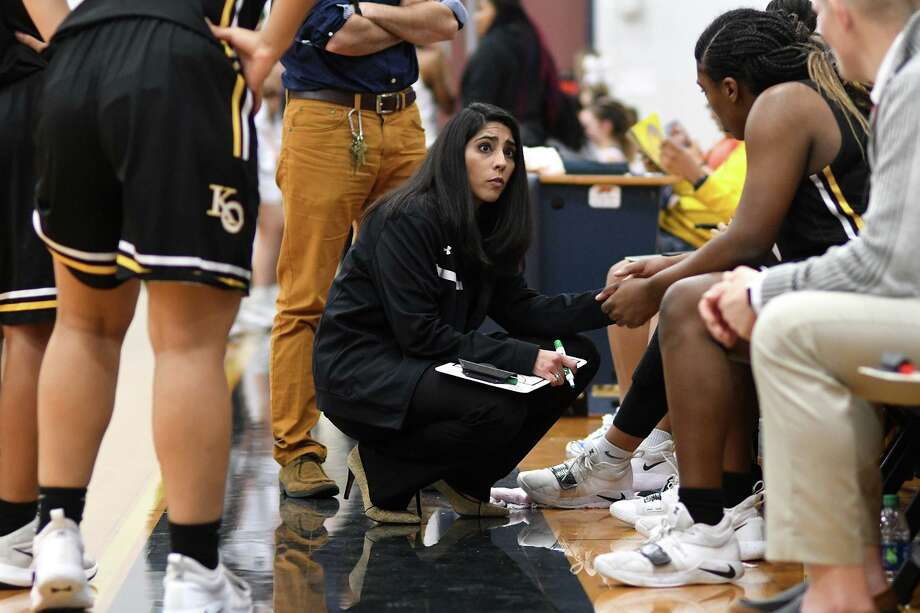 Klein Oak Head Girls Basketball Coach Adrianna Bendick, center, tries to pump up her team during a timeout against Klein Collins in their District 15-6A matchup at Klein Collins High School on Jan. 18, 2019. Photo: Jerry Baker, Houston Chronicle / Contributor / Houston Chronicle