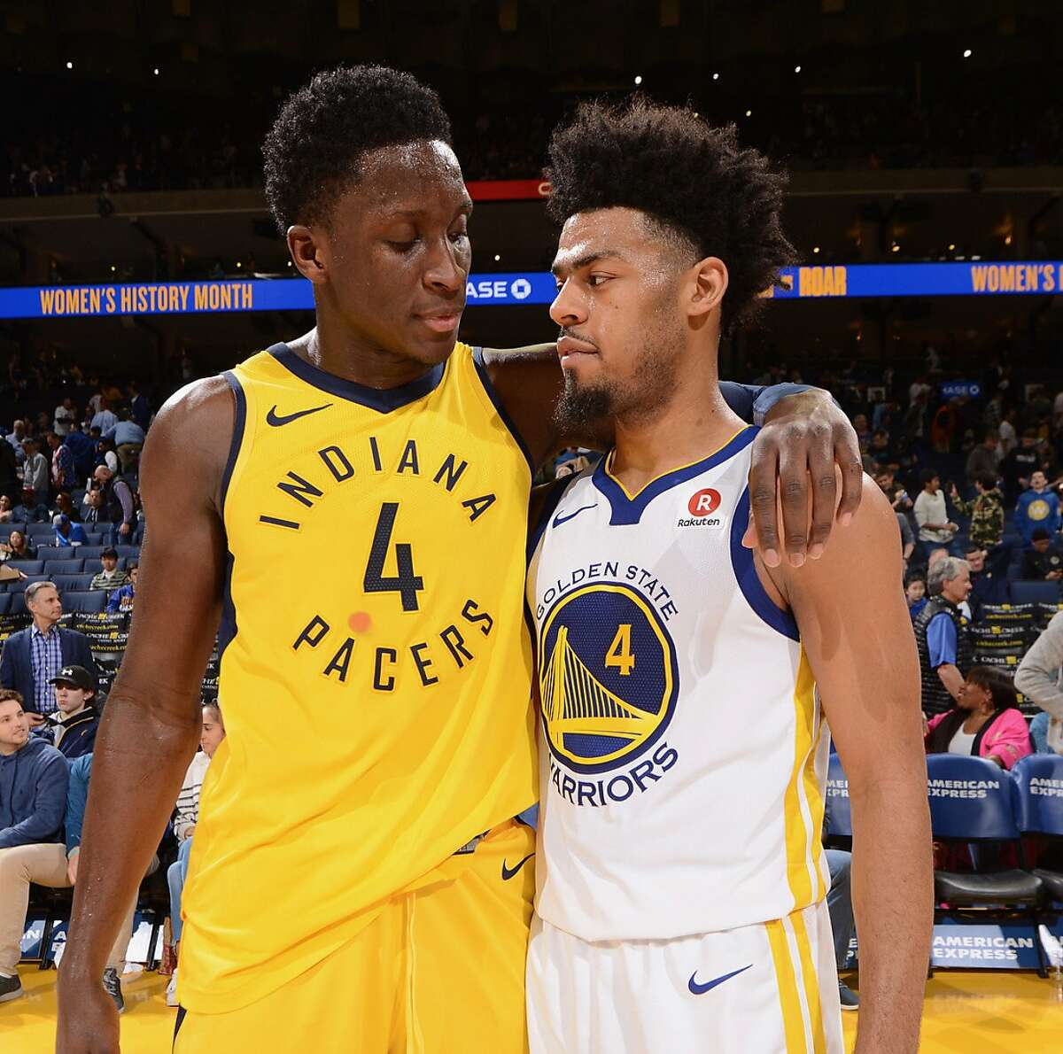 Quinn Cook and Victor Oladipo embrace after a Pacers-Warriors game.