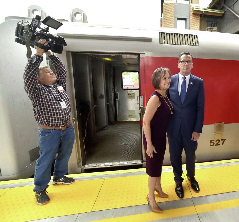 In this file photo, then-Gov. Dannel P. Malloy, poses with Quinnipiac Chamber of Commerce Executive Director Dee Prior at the Wallingford train station during the inaugural run of the new CTrail Hartford Line Connecticut Rail commuter service launched in June 2018. Photo: Peter Hvizdak / Hearst Connecticut Media File Photo / New Haven Register