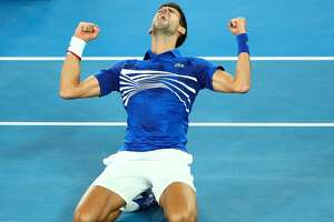 MELBOURNE, AUSTRALIA - JANUARY 27:  Novak Djokovic of Serbia celebrates after winning championship point in his Men's Singles Final match against Rafael Nadal of Spain during day 14 of the 2019 Australian Open at Melbourne Park on January 27, 2019 in Melbourne, Australia.  (Photo by Scott Barbour/Getty Images)