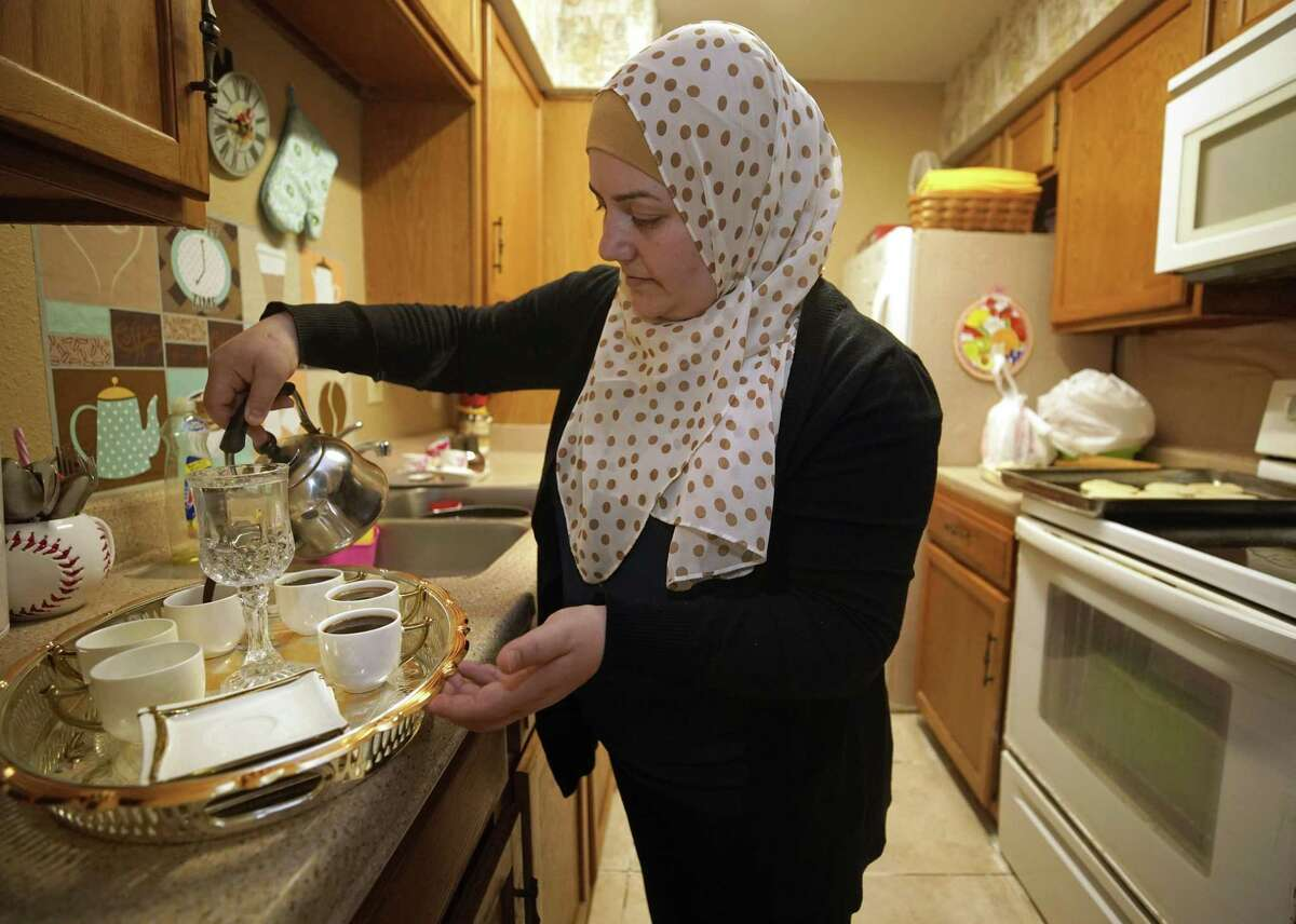 Amal Karkoura prepares coffee at her Gulfton area apartment Friday, Jan. 25, 2019, in Houston. The Gulfton area has one of the highest concentrations of struggling households in the city of Houston according to a new report from United Way.