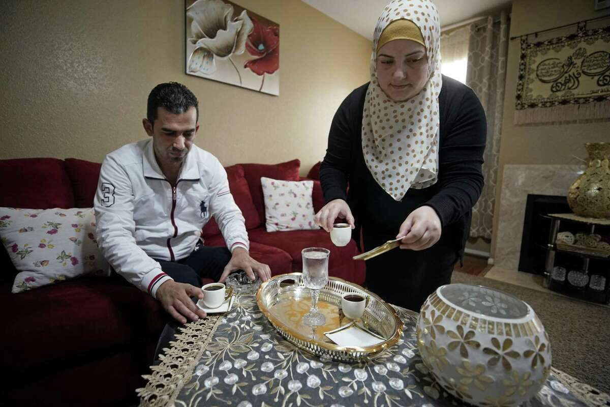 Mohamad Khir Alakish and his wife, Amal Karkoura, have coffee in their Gulfton area apartment Friday, Jan. 25, 2019, in Houston. The Gulfton area has one of the highest concentrations of struggling households in the city of Houston according to a new report from United Way.