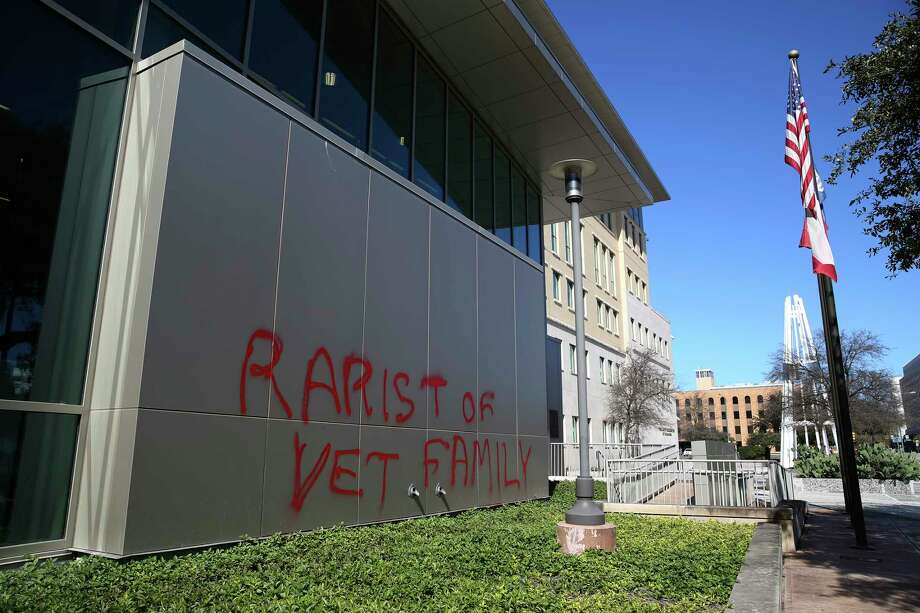Vandals tag a wall at the San Antonio Public Safety Headquarters on South Frio Street, Sunday, Jan. 27, 2019. Photo: Jerry Lara, Staff Photographer / © 2019 San Antonio Express-News