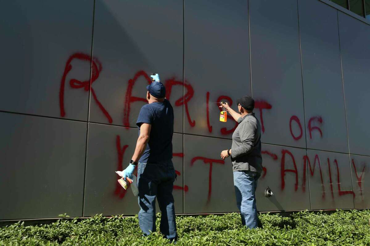 City workers remove graffiti from a wall at the San Antonio Public Safety Headquarters on South Frio Street, Sunday, Jan. 27, 2019.