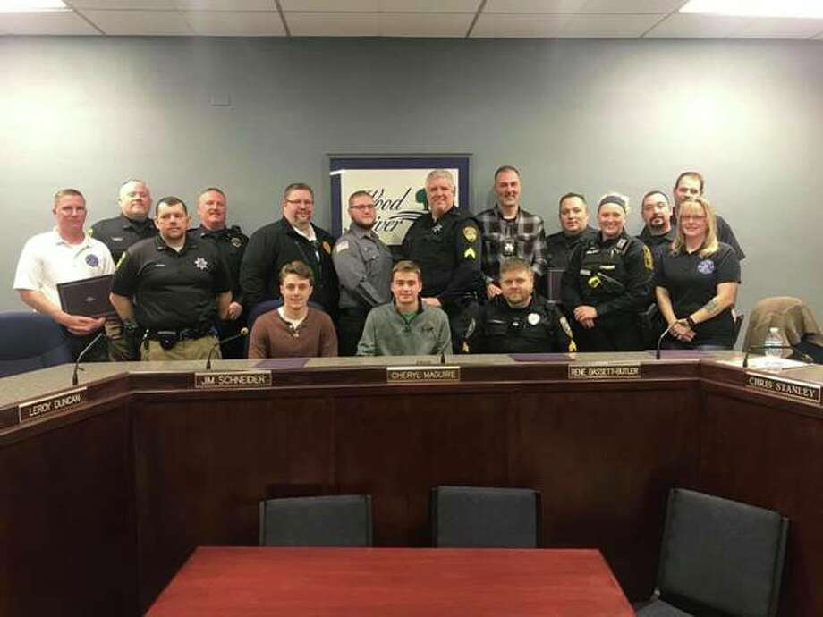 Many first responders and a civilian were honored at Tuesday's Wood River City Council meeting for live-saving efforts in a crash last May. Photo: Photo By Wood River Police Department