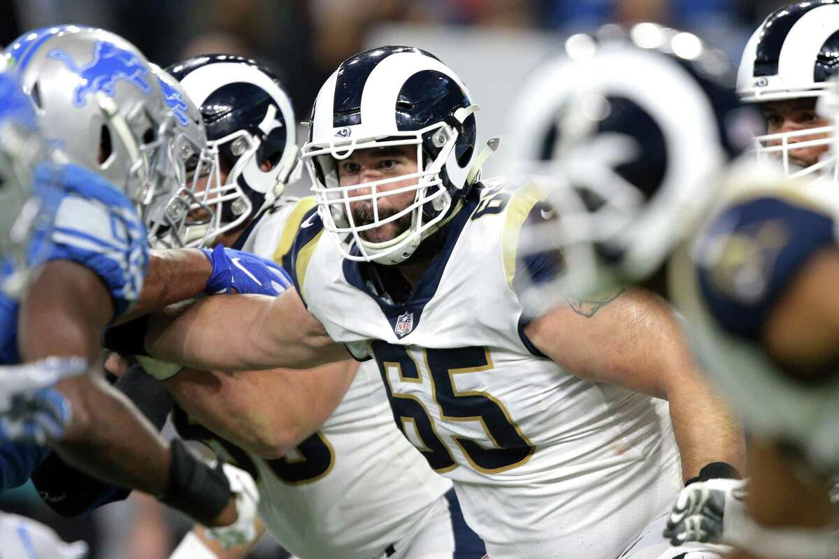 Rams center John Sullivan (65) blocks against the Lions in Detroit on Dec. 2. Sullivan, a Greenwich High School grad and 10-year NFL veteran, will play in his first Super Bowl on Sunday against the Patriots.