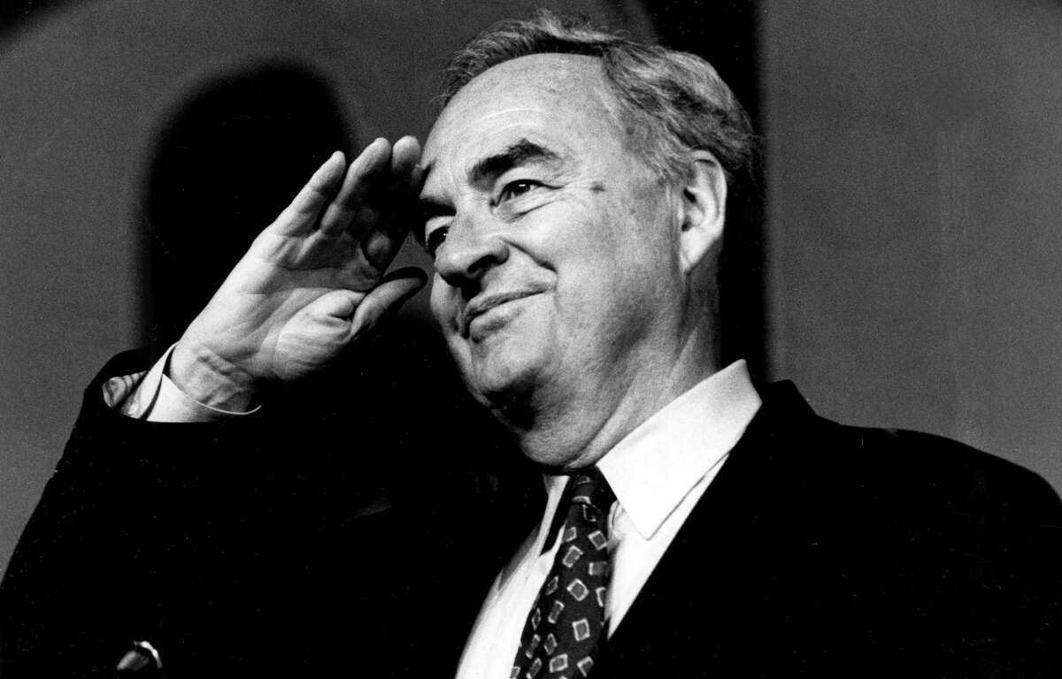 In this April 26, 1994, photo, Sen. Harris Wofford, D-Pa., salutes at the Pittsburgh Hilton and Towers during the opening session of the Pennsylvania AFL-CIO convention. Former Pennsylvania Sen. Harris Wofford died in the hospital late Monday night, Jan. 21, 2019, of complications from a fall Saturday in his Washington apartment, his son, Daniel Wofford, said. He was 92. (Peter Diana/Pittsburgh Post-Gazette via AP)