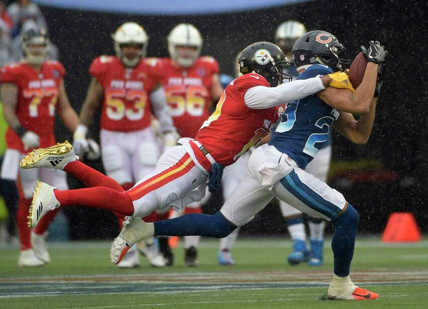 NFC cornerback Kyle Fuller (23), of the Chicago Bears, intercepts a pass intedned for AFC wide receiver Juju Smith-Schuster (19), of the Pittsburgh Steelers, during the first half of the NFL Pro Bowl football game Sunday, Jan. 27, 2019, in Orlando, Fla.