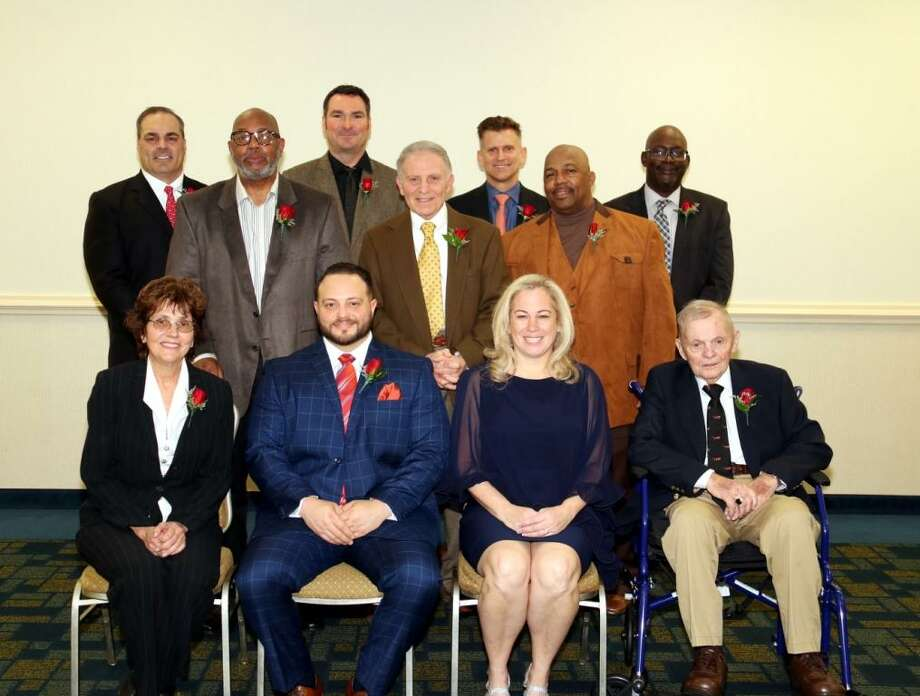 The 11 individual inductees for the Middletown Hall of Fame are pictured. Front row, from left, are Mary Mesek, Nick Puorro, Danielle Benoit-Egidio and Fred Norton. Second row standing, from left, are John Raba, Ron Edens for Dan Thompson (posthumous), Hugh O'Gorman, Robert Trigo, Matt Moravek, Rodney Privott and Otis Rankins. Photo: Submitted Photo