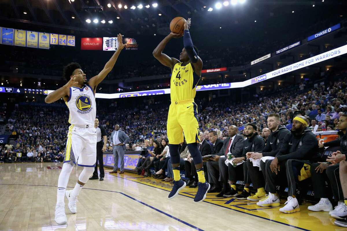 Victor Oladipo #4 of the Indiana Pacers shoots over Quinn Cook #4 of the Golden State Warriors at ORACLE Arena on March 27, 2018 in Oakland, California.