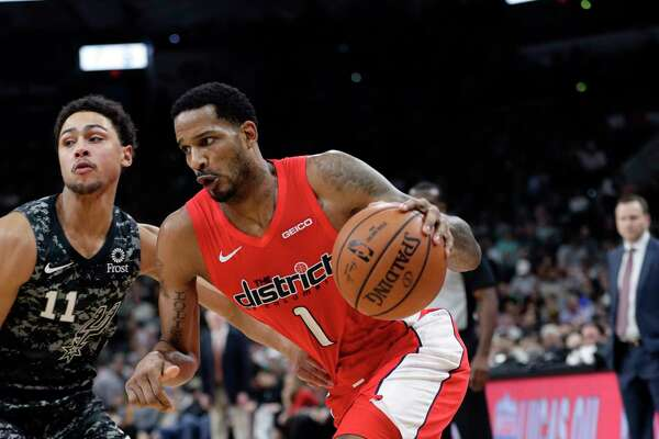 Washington Wizards forward Trevor Ariza (1) drives around San Antonio Spurs guard Bryn Forbes (11) during the first half of an NBA basketball game in San Antonio, Sunday, Jan. 27, 2019. (AP Photo/Eric Gay)
