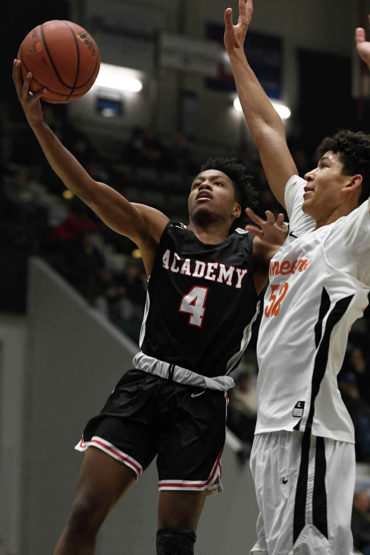 Park School's Caleb Hutchins guards Albany Academy's Isaiah Danzy as he takes a shot during a game of the Zero Gravity Slam North-South Classic in Glens Falls, N.Y., on Sunday, Jan. 27, 2019. (Jenn March, Special to the Times Union)
