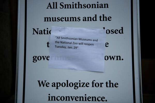 A sign outside the Smithsonian American History Museum lets visitors know when it will be open again while the U.S. government prepares for a temporary three-week reopening on the National Mall in Washington, D.C.