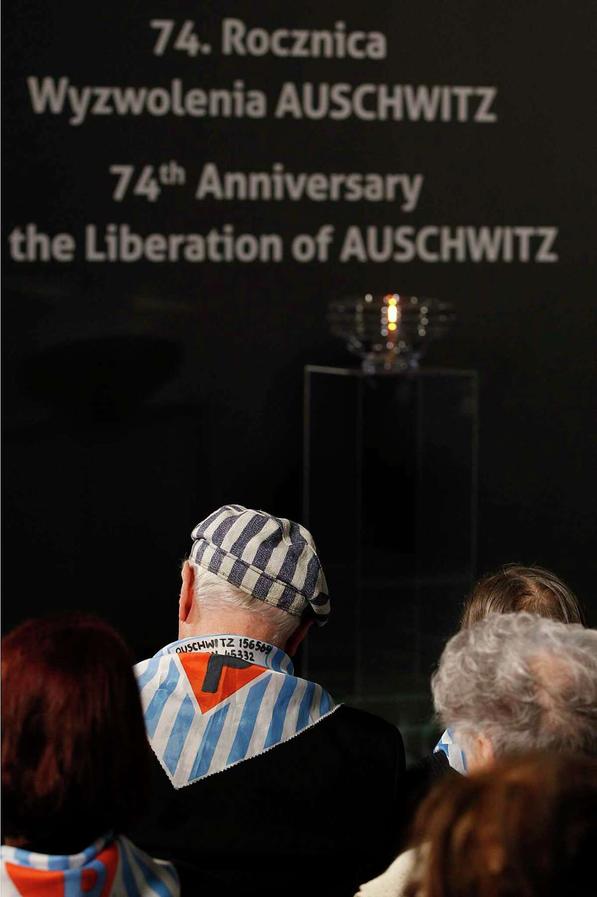 Survivors attend a commemoration event in the so-called