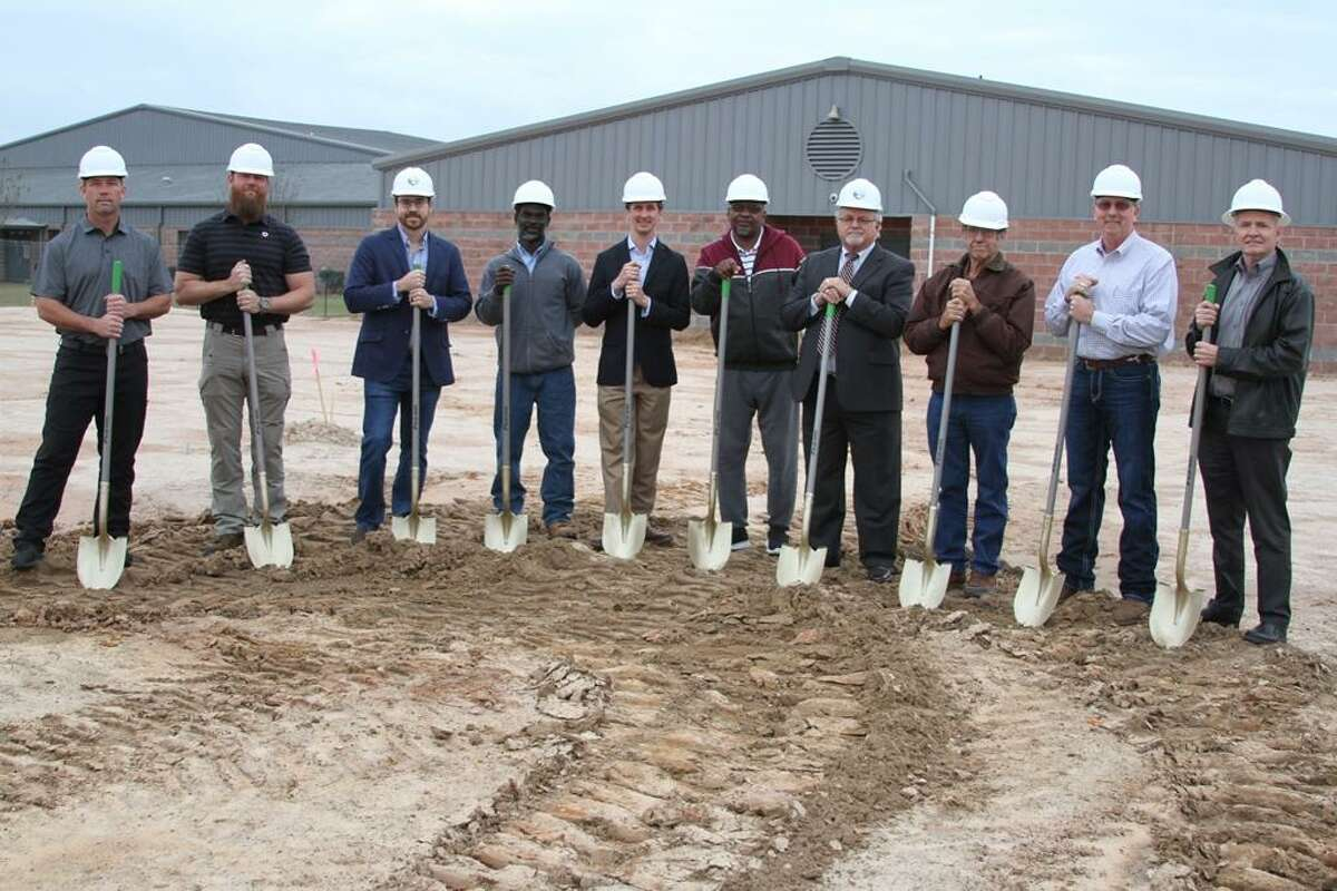 COCISD school board members and administrators broke ground on the Coldspring-Oakhurst High School Career and Technical Education building on Tuesday, Jan. 22. From left, COCISD Trustee Travis Dean, Trustee Daniel Williams, David Golden, principal architect for McKinley-Golden Architects, LLC, Clifton Hunt, project superintendent for Berry and Clay Construction, COCISD Asst. Superintendent of Business and Finance Adam Jenke, Construction Consultant Johnny Washington, Superintendent Dr. Leland R. Moore, Trustee/Secretary Dale Richards, Trustee/Vice President Tony Sewell, and Danny Berry, president of Berry and Clay Construction.