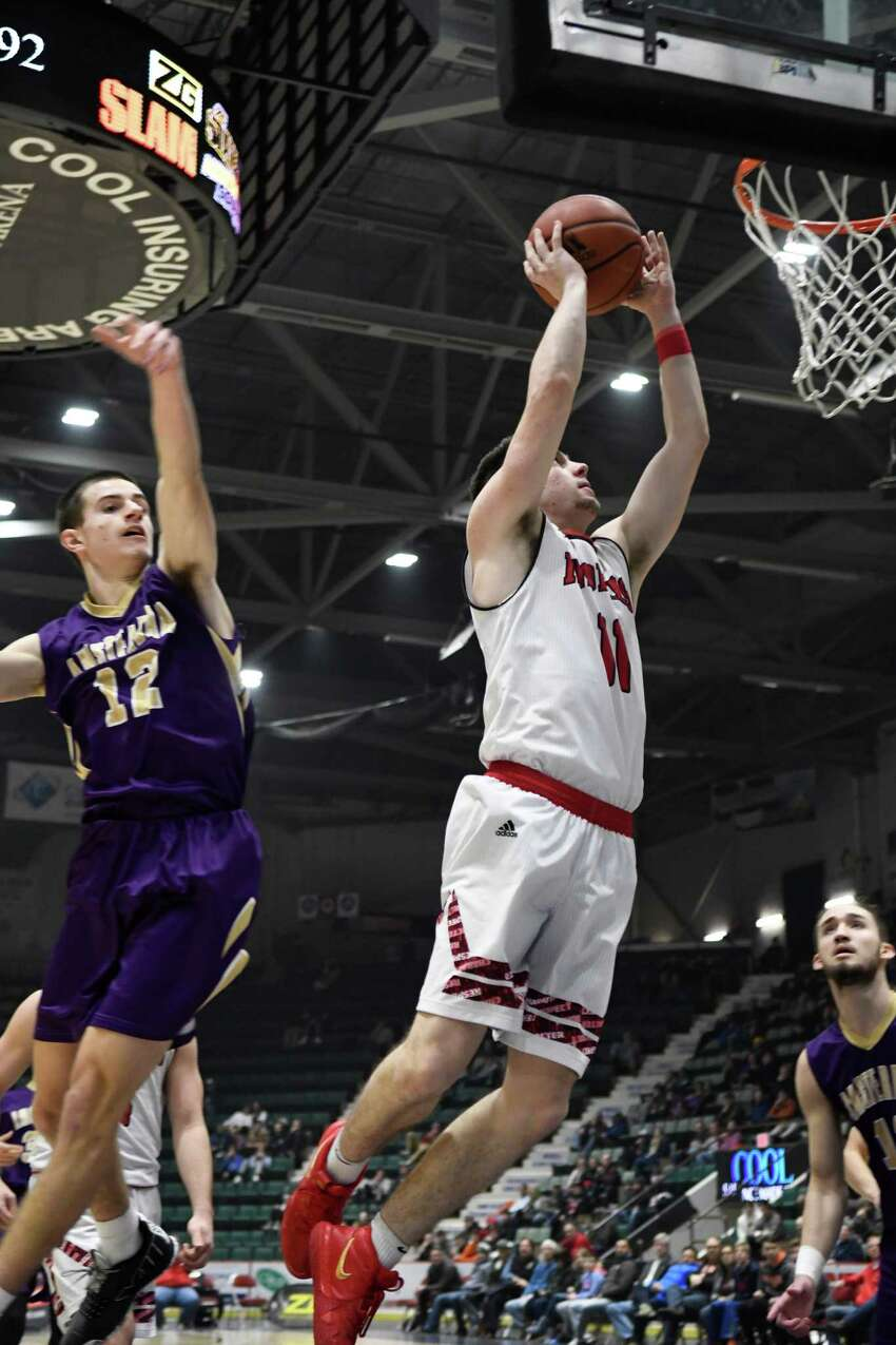 Glens Falls's Joe Girard III works his way to 4,000 career points at the Zero Gravity Slam North-South Classic in a game against Amsterdam at Cool Insuring Arena in Glens Falls, N.Y., on Sunday, Jan. 27, 2019. Girard became the sixth high school player in the country ever to score 4,000 career points. (Jenn March, Special to the Times Union)