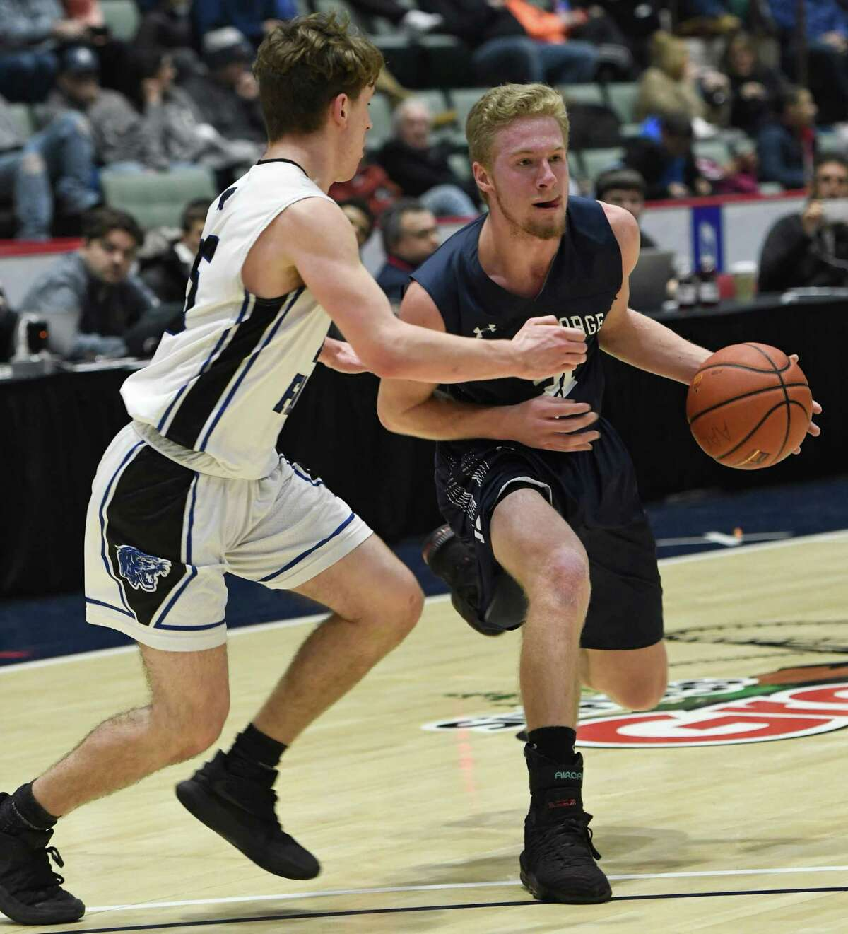 Hoosick Falls's Max Kipp guards Lake George's Mason Flatley during a game of the Zero Gravity Slam North-South Classic in Glens Falls, N.Y., on Sunday, Jan. 27, 2019. (Jenn March, Special to the Times Union)