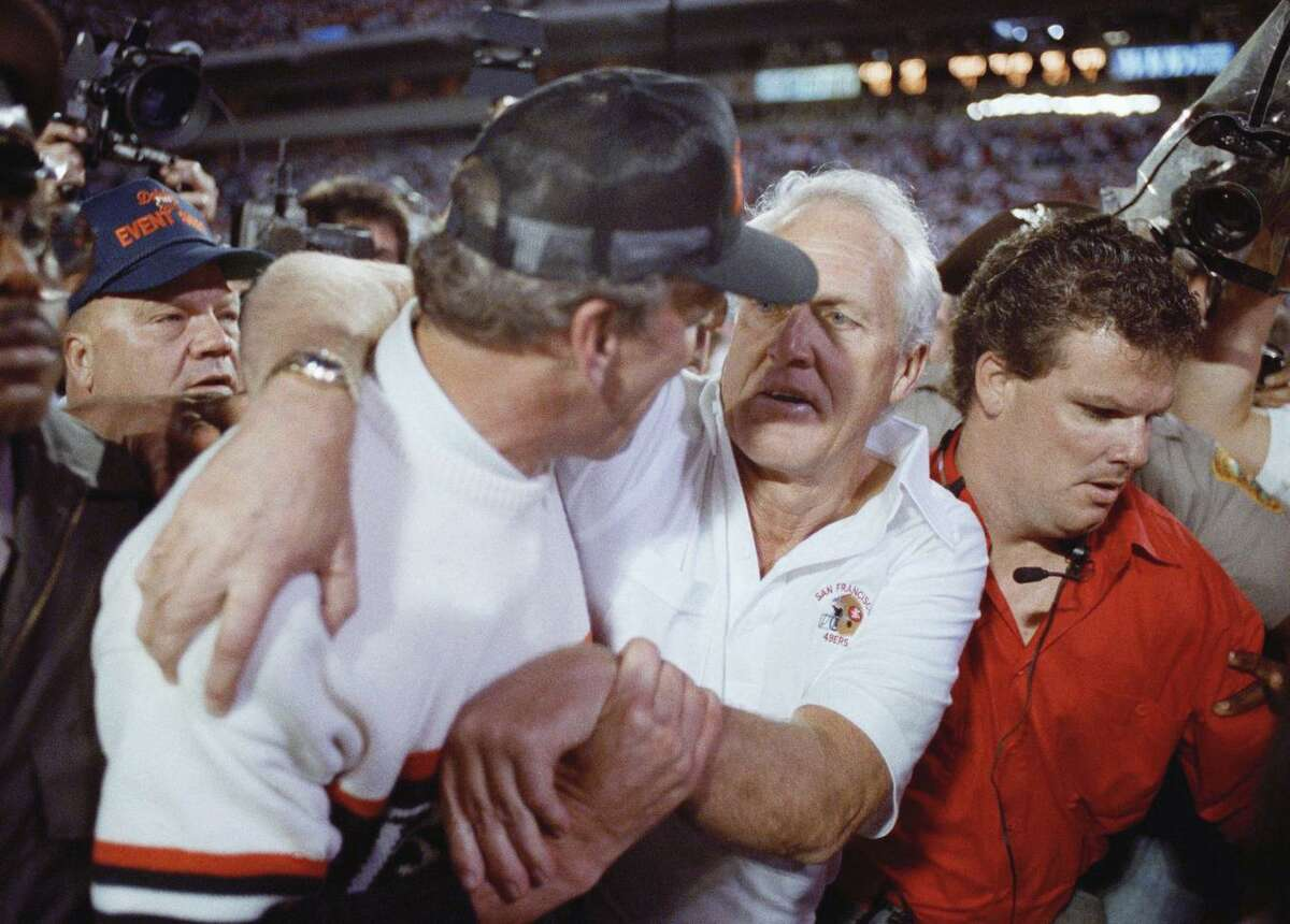 Cincinnati Bengals coach Sam Wyche, left, congratulates San Francisco 49ers coach Bill Walsh after the 49ers beat the Bengals 20-16 in Super Bowl XXIII in Miami on Sunday, Jan. 22, 1989.