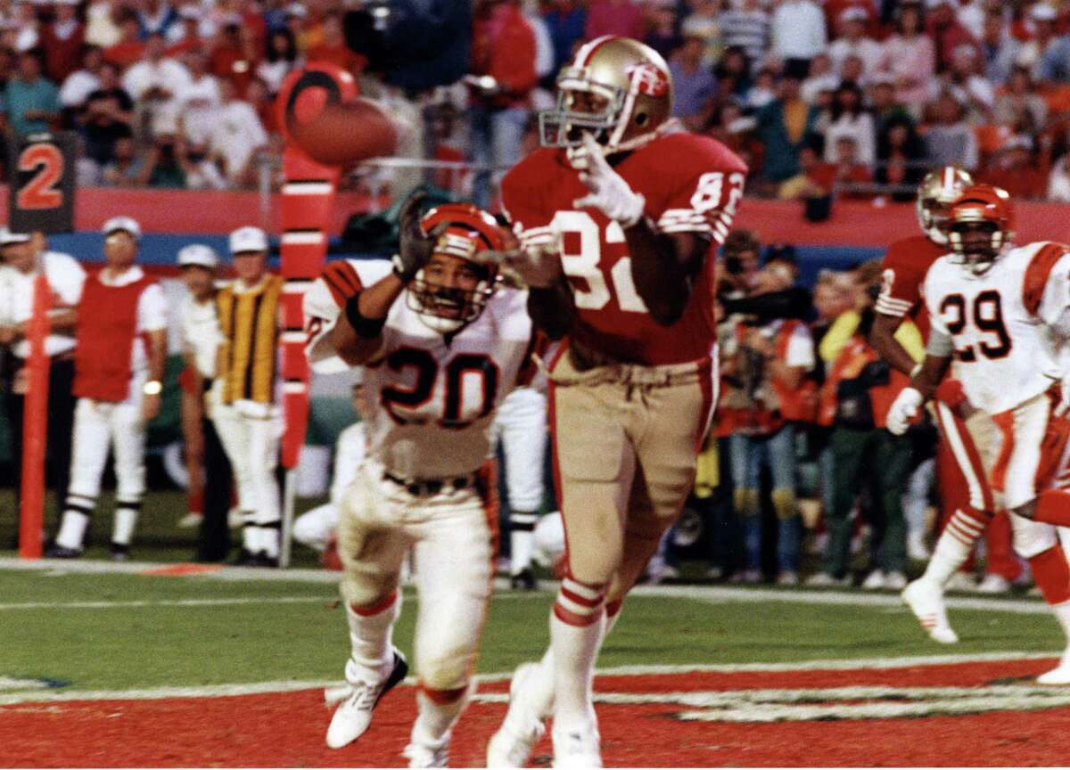 Niners receiver John Taylor reaches for the football, the result being a game-winning 10-yard touchdown reception in the final moments of Super Bowl XXIII.
