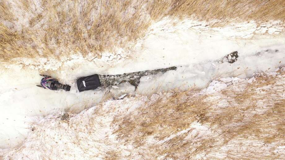 Tuscola County Sheriff officers rescued a man who along with his snow machine broke through the ice off of Hidden Harbor. The sheriff department used its drone to capture this aerial photo of the incident.