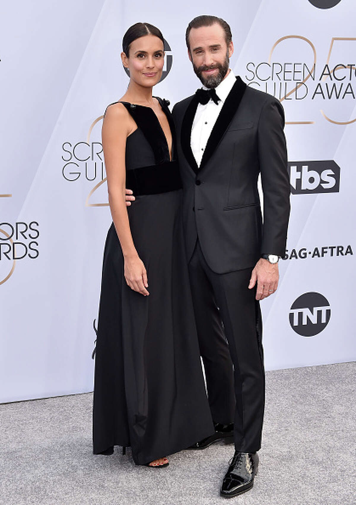 LOS ANGELES, CA - JANUARY 27: Maria Dolores Dieguez (L) and Joseph Fiennes attend the 25th Annual Screen Actors Guild Awards at The Shrine Auditorium on January 27, 2019 in Los Angeles, California. (Photo by Axelle/Bauer-Griffin/FilmMagic)