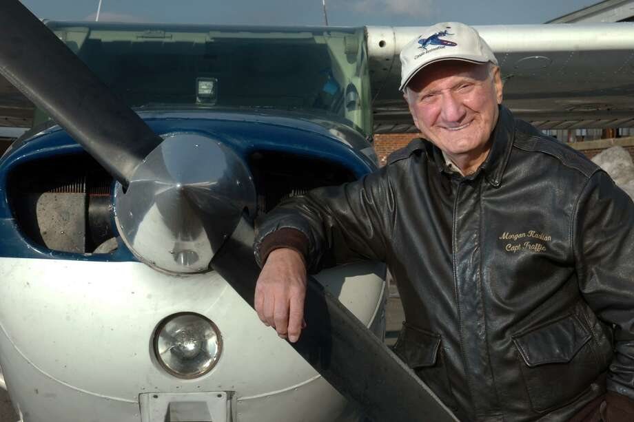 Morgan Kaolian poses next to one of his airplanes at Sikorsky Memorial Airport in Stratford, Jan. 6th, 2011. Photo: Ned Gerard / Hearst Connecticut Media / Connecticut Post