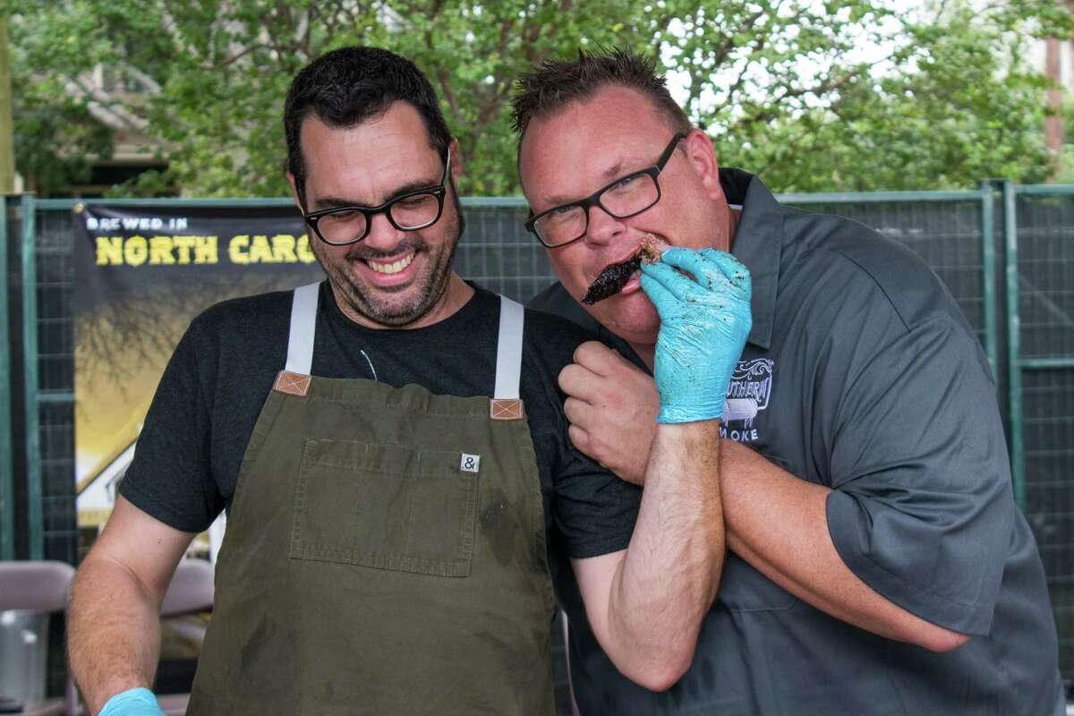 Aaron Franklin, a Southern Smoke participant since the inaugural festival, feeds Chris Shepherd brisket at the 2018 festival. Franklin, owner of Franklin Barbecue in Austin, will join Shepherd for a special dinner at Southern Smoke Spring on April 14 at Shepherd's Georgia James restaurant.