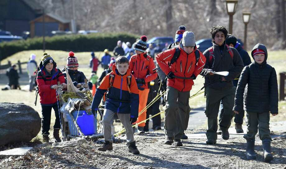 Members of Boy Scout Troop 35 Phoenix Patrol use Scout power to pull a Klondike Sled loaded with gear to various stations named after famous Klondike Gold Rush towns during the annual Klondike Derby at the Ernest Thompson Seton Scout Reservation in Greenwich, Connecticut on Saturday, Jan. 26, 2019. Over 75 scouts competed in a winter camping and outdoor skills competition. Photo: Matthew Brown / Hearst Connecticut Media / Stamford Advocate
