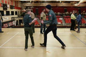 "Sam Dion, left, and Mark Boyd, right, both of Venturing Crew 343 of Mt. Zion, Illinois, face off against each other while playing, ""Cowboy, Ninja, Bear,"" a team building and break-the-ice game during a station at the Greater St. Louis Area Council for the Boys Scouts of America's annual University of Scouting event held on the campus of SIUE on Saturday."