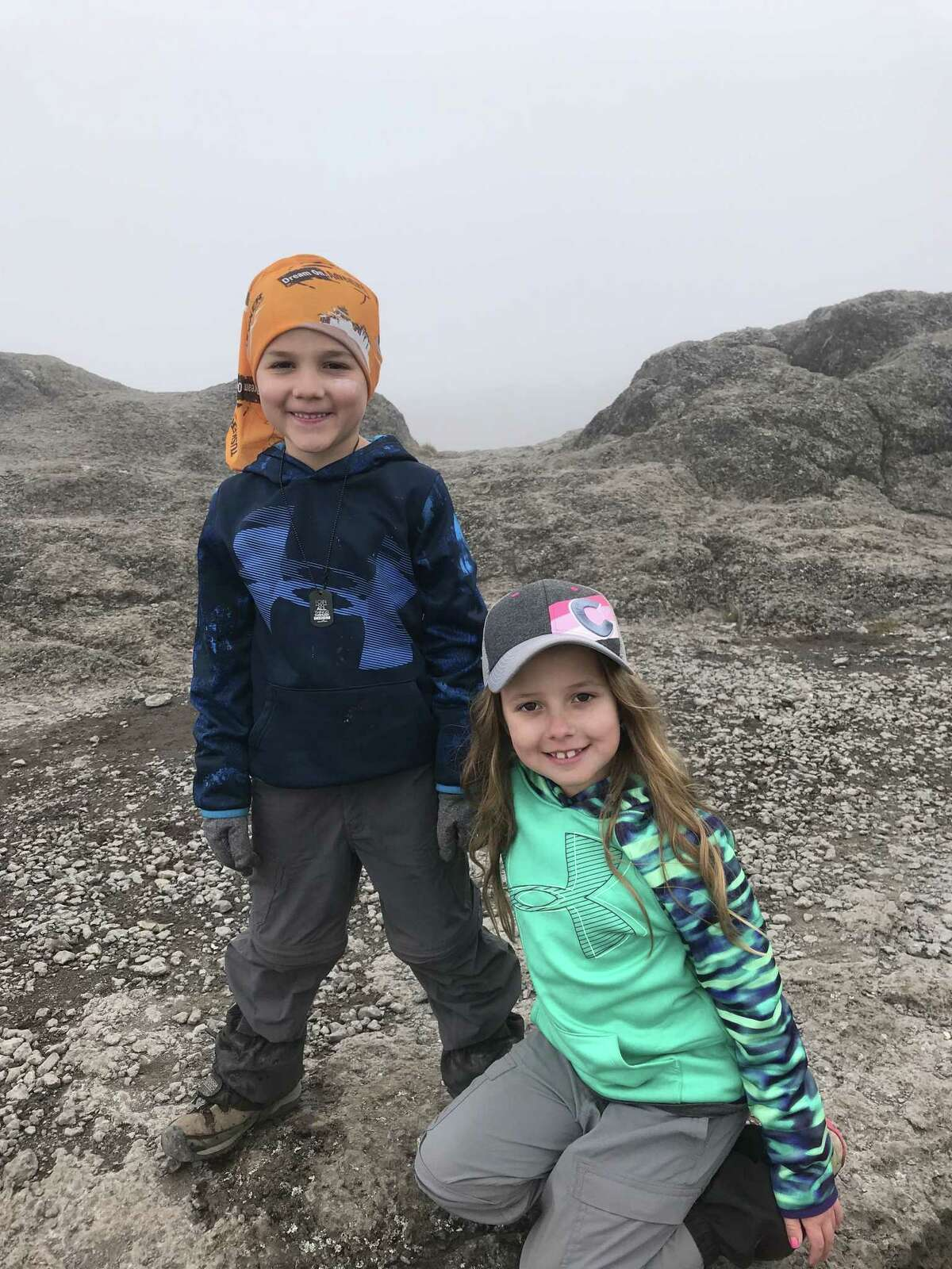 Joel and Charli Redmond say they were thrilled to reach the summit on Mount Kilimanjaro with their parents.