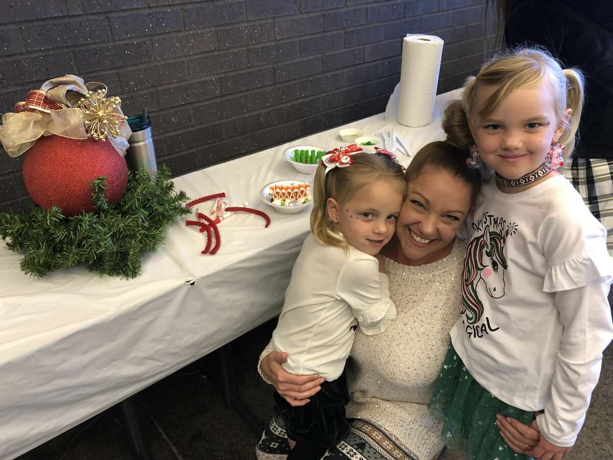 Gingerbread houses: Alea Davis, from left, Belle Davis and Anne Davis