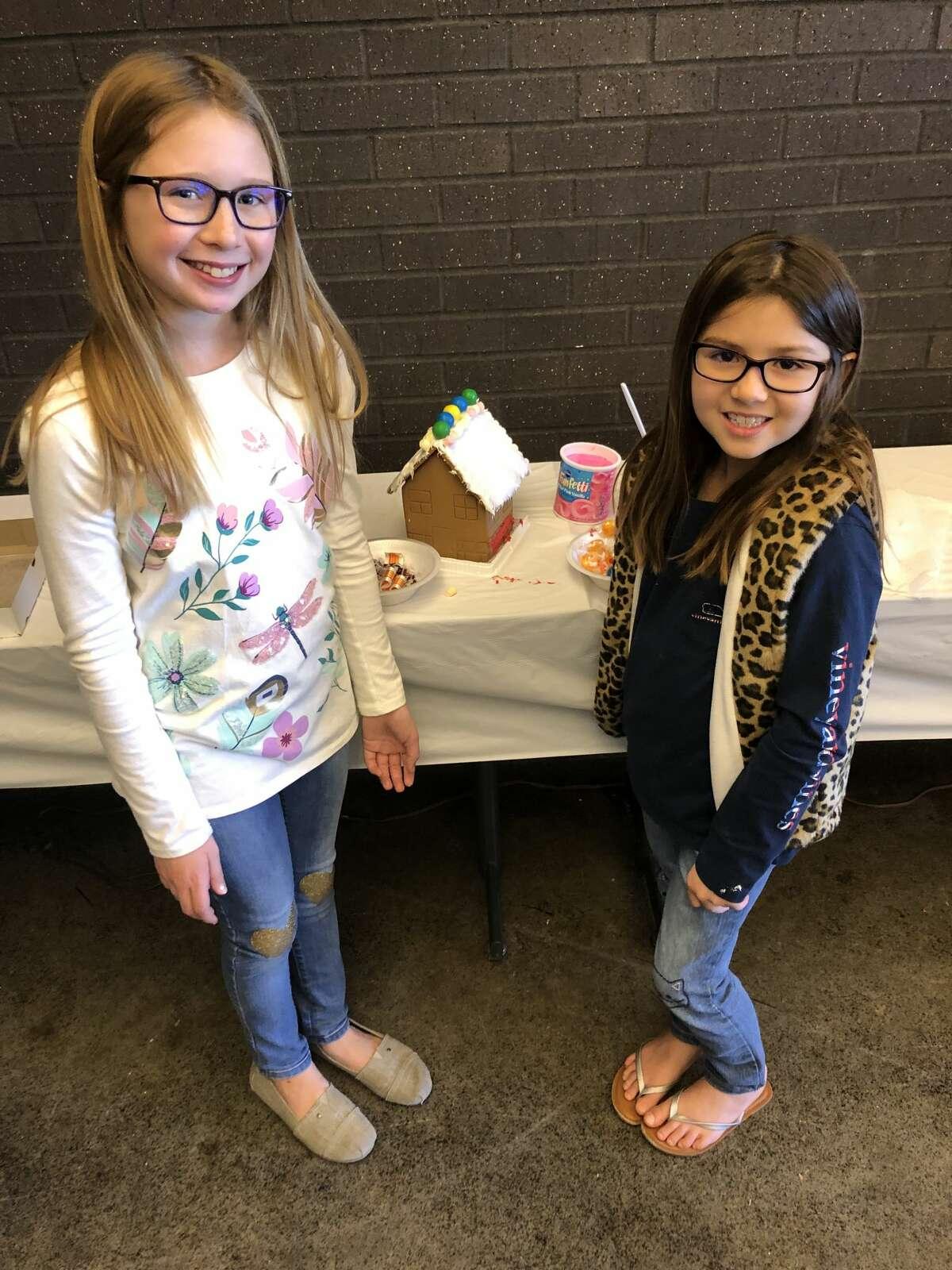 Gingerbread houses: Iva Garza, left, and Cora Garza