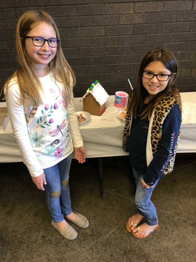 Gingerbread houses: Iva Garza, left, and Cora Garza Photo: Courtesy Photo